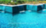 American Made Lightstreams Glass Tile Renaissance Collection Teal blue tile / green tile is used as pool tile, wall tile, fountain tile, and spa tile in this all tile pool and all tile spa