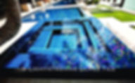 American Made Lightstreams Glass Tile Renaissance Collection Peacock is used as pool tile and spa tile for this all tile pool and all tile spa. Accent tile and step marker tile is used with Renaissance Collection Aqua Blue tile.