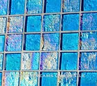 High quality American Made Lightstreams Glass Tile Renaissance Collection II Aqua 2.0 glass tiles are light blue in color, with subtle rainbow iridescent colors on the reverse textured side. This blue tile can also be used for pool tile, spa tile, fountain tile, fire pit tile, wall tile, waterline tile, step marker tile, exterior tile, interior tile, accent tile, iridescent tile, backsplash tile, kitchen tile, bathroom tile, floor tile, and shower tile