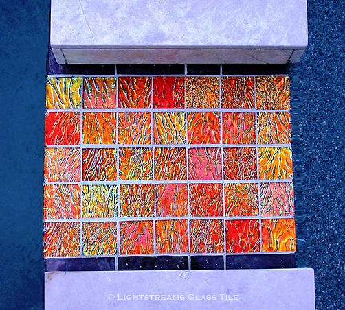 "American made Lightstreams Glass Tile Jewel Orange Crush accent tile, a brilliant spa to pool spillway is tiled with Orange Crush 2""x2"" Jewel glass accent tiles. Also can be used as spa tile, pool tile, waterline tile, bathroom tile, floor tile, backsplash tileand kitchen tile,"