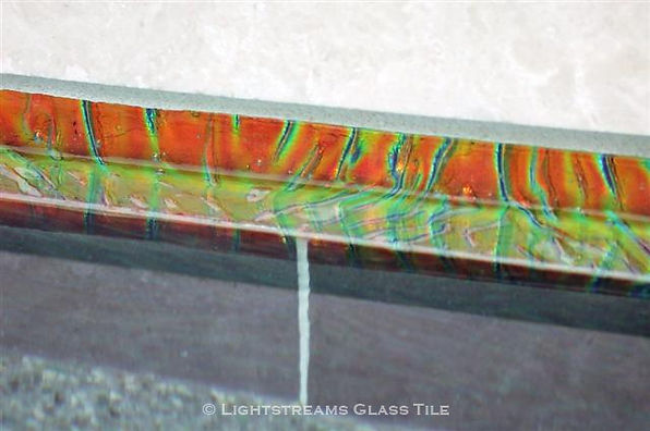 American Made Lightstreams Glass Tile Orange Crush Jewel glass tile liner bars top the waterline tile of the same swimming pool. Also can be used as accent tile for shower tile, bathroom tile, pool tile, spa tile, kitchen tile, backsplash tile, orange tile, spa tile, fountain tile, spillway tile, floor tle, waterline tile, and step marker tile.