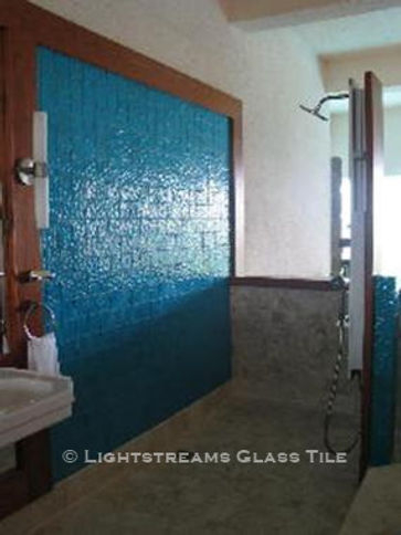 American Made Lightstreams Glass Tile Renaissance Colllection Aqua Blue tile is used as shower tile, bathroom tile, and wall tile in this indoor / outdoor bathroom.  Only the shiny side of this iridescent / shiny reversible tile is shown in this bathroom tile photo