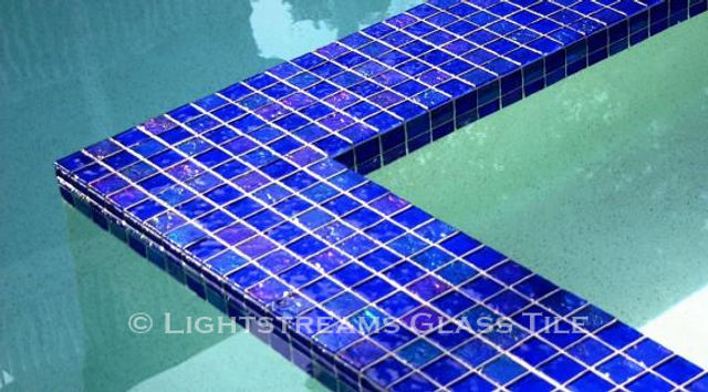 American Made Lightstreams Glass Tile Renaissance Collection Intense Blue tile is mixed with Lightstreams Jewel accent tile to be a decorative touch as pool tile, spa tile, waterline tile, wall tile, fountain tile, sun shelf tile, and step marker tile