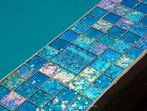 American Made Lightstreams Glass Tile Reniassance Collection Aqua Blue tiled pool cover ledge is accented with Jewel Mystic Spring accent tile which can also be used as blue tile green tile accent tile as shower tile, pool tile, spa tile, kitchen tile, backsplash tile, bathroom tile, fountain tile, wall tile, waterline tile, and step marker tile