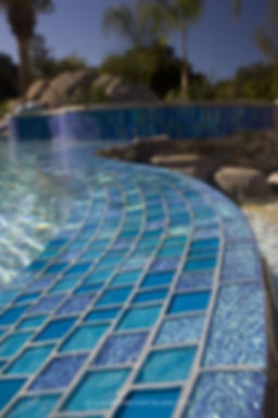 "American made Lightstreams Glass Tile Renaissance Collection Turquoise and Aqua Blue glass pool tile are accented with Lightstreams Mystic Spring Jewel glass accent tiles in this gorgeous pool spillway.  The spillway is also edged in Lightstreams Mystic Spring 2""x6"" bullnose glass tile trim pieces.  Also can be used as accent tile for shower tile, floor tile, spillway tile, step marker tile, wateline tile, backsplash tile, fountain tile, bathroom tile, kitchen tile, blue tile, green tile, and spa tile"