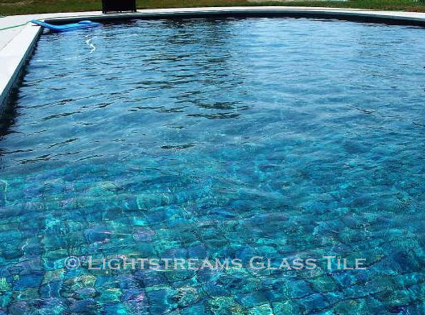 American Made Lightstreams Glass Tile Renaissance Collection Teal blue tile / green tile is used as pool tile and spa tile in this all tile pool and all tile spa showing the iridescent side of Lightstreams signature iridescent tile / shiny tile reversible tile.
