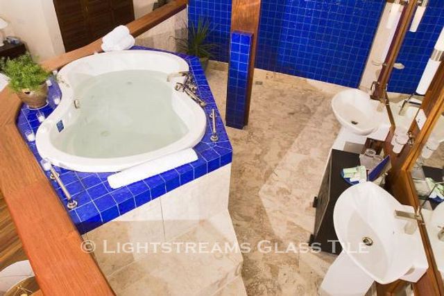 American Made Lightstreams Glass Tile Renaissance Collection Intense Blue tile is used as wall tile and shower tile in this glass tile bathroom. This bathroom tile is showing only the shiny side of this shiny / iridescent tile