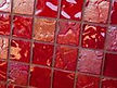 High quality American made Lightstreams Glass Tile Gold Iridescent Collection Crimson glass tiles are a rich, deep merlot red color on the shiny side of the tile, with metallic iridescent colors on the reverse side. This red tile can be used for pool tile, spa tile, wall tile, floor tile, backsplash tile, kitchen tile, shower tile, bathroom tile, waterline tile, step marker tile, fountain tile, spillway tile, and even accent tile,