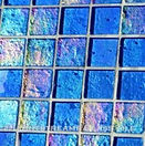 High quality American Made Lightstreams Glass Tile Renaissance Collection II Sky Blue 2.0 glass tiles are a light blue (baby blue / robin egg's blue) with a hint of lilac (not quite periwinkle).  There are subtle rainbow iridescent colors on the reverse textured side. This blue tile can also be used for pool tile, spa tile, fountain tile, fire pit tile, wall tile, waterline tile, step marker tile, exterior tile, interior tile, accent tile, iridescent tile, backsplash tile, kitchen tile, bathroom tile, floor tile, and shower tile