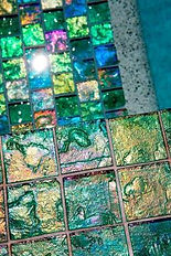 American made Lightstreams Glass Tile is used for pool tile, spa tile, waterline tile, step marker tile, accent tile, wall tile, fountain tile, floor tile, bathroom tile, shower tile, kitchen tile, and kitchen backsplash tile. This swimming pool and pool steps are using Lightstreams Renaissance Collection Celadon in 2x2 tile size.