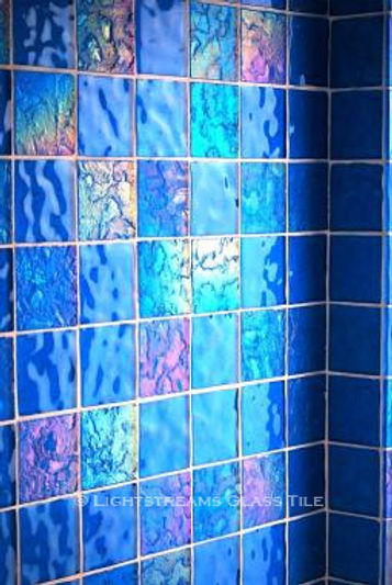 American Made Lightstreams Glass Tile Turquoise is used as bathroom tile, shower tile, and wall tile for this all tile bathroom. This bathroom displays both sides of Lightstreams iridescent / shiny reversible blue tile.