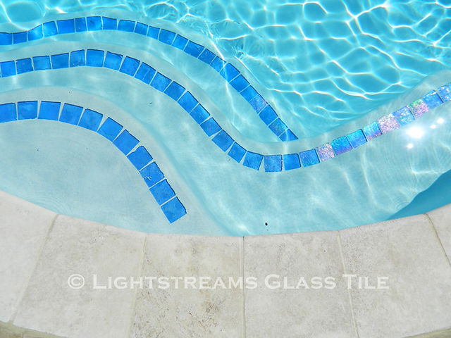 American Made Lightstreams Glass Tile Renaissance Collection Sky Blue tile is used as step marker tile, accent tile for the pool steps, pool tile, and spa tile