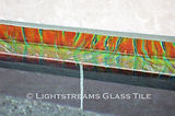 American made Lighstreams Glass Tile Orange Crush jewel accent tile pool tile on the waterline