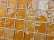 High quality American made Lightstreams Glass Tile Gold Iridescent Collection Amber glass tiles are a golden caramel / tan color on the shiny side of the tile, with metallic iridescent colors on the reverse side. This yellow tile / orangle tile can be used for pool tile, spa tile, wall tile, floor tile, backsplash tile, kitchen tile, shower tile, bathroom tile, waterline tile, step marker tile, fountain tile, spillway tile, and even accent tile,