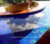 American Made Lightstreams Glass Tile Renaissance Collection Intense Blue tile is used as pool tile and spa tile for this all tile pool with the iridescent tile side only showing