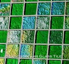 High quality American Made Lightstreams Glass Tile Renaissance Collection II Spring Green 2.0 glass tiles are bright apple green in color.  There are colorful rainbow iridescent colors on the reverse textured side of the tile. This green tile can also be used for pool tile, spa tile, fountain tile, fire pit tile, wall tile, waterline tile, step marker tile, exterior tile, interior tile, accent tile, iridescent tile, backsplash tile, kitchen tile, bathroom tile, floor tile, and shower tile