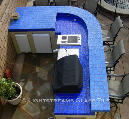American Made Lightstreams Glass Tile Renaissance Collection Sky Blue tile is used as barbecue tile, counter top tile, exterior tile, and outdoor kitchen tile  with only the shiny side showing