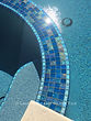 American made Lightstreams Glass Tile Renaissance Collection Peacock Blue tile as pool tile, spa tile, and waterline tile with jewel accent tile as step markers