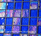 High quality American Made Lightstreams Glass Tile Renaissance Collection II Intense Blue 2.0 glass tiles are a shiny medium true blue on one side, with colorful rainbow iridescent colors on the reverse textured side. This blue tile can also be used for pool tile, spa tile, fountain tile, fire pit tile, wall tile, waterline tile, step marker tile, exterior tile, interior tile, accent tile, iridescent tile, backsplash tile, kitchen tile, bathroom tile, floor tile, and shower tile