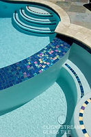 American Made Lightstreams Glass Tile Renaissance Collection Peacock is used for this pool and spa tile as well as accent tiles used as step markers. Lightstreams pool tile can als be used for wall tile, floor tile, bathroom tile, shower tile, kitchen tile, glass backsplash tile, waterline tile and fountain tile.