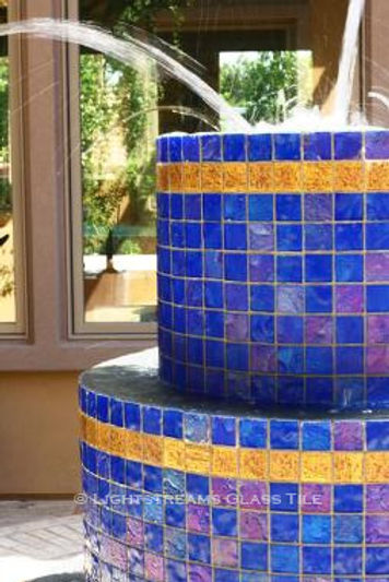 American Made Lightstreams Glass Tile Renaissance Collection Intense Blue tile is used as fountain tile for ths all glass tile outdoor fountain and has accent tile from Lightstreams 24k Gold Tile