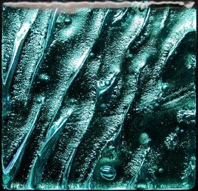 American Made Lightstreams Glass Tile, High quality American-manufactured Lightstreams Aqia Bliss Jewel glass accent tiles have a complex wavy aqua (green/blue) metallic pattern. Green Tile / Blue Tile which can be used as accent tile for pool tile, spa tile, waterline tile, floor tile, wall tile, step glass tile, step markers, fountain tile, kitchen tile, backsplash tile, shower tile, bathroom tile, and spillway tile