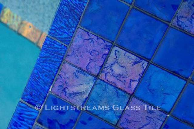 American Made Lightstreams Glass Tile Renaissance Collection Intense Blue tile is mixed with Lightstreams Jewel accent tile to be a decorative touch as pool tile, spa tile, waterline tile, wall tile, fountain tile, and step marker tile