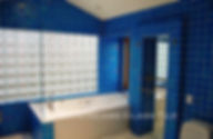 American Made Lightstreams Glass Tile Turquoise is used as bathroom tile, shower tile, and wall tile for this all tile bathroom. This bathroom mostly displays the shiny smooth side of Lightstreams iridescent / shiny reversible blue tile.