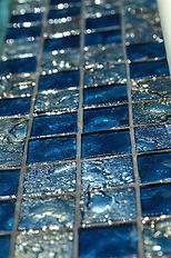 American made Lightstreams Glass Tile is used for pool tile, spa tile, waterline tile, step marker tile, accent tile, wall tile, fountain tile, floor tile, bathroom tile, shower tile, kitchen tile, and kitchen backsplash tile. This swimming pool and spa is done is Lightstreams Gold Iridescent Collection Steel Blue in 2x2 tile size.