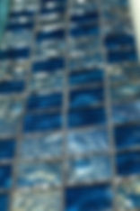 American made Lightstreams Glass Tile is used for pool tile, spa tile, waterline tile, step marker tile, accent tile, wall tile, fountain tile, floor tile, bathroom tile, shower tile, kitchen tile, and kitchen backsplash tile. This swimming pool and spa is done is Lightstreams Gold Iridescent Collection Steel Blue in 2x2 tile size.