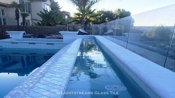 American made white tile glass pool waterline wall made with Lightstreams Glass Tile High Noon Jewel glass accent tiles: also can be used as accent tile for shower tile, backsplash tile, kitchen tile, bathroom tile, floor tile, pool tile, waterline tile, step marker tile, spillway tile, fountain tile, spa tile, and wall tile
