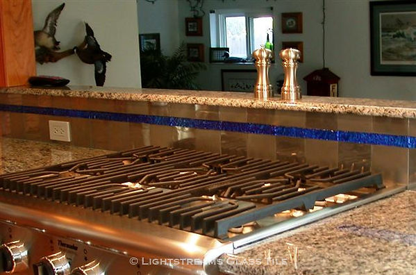 "stainless steel kitchen backsplash tile is accented with Lightstreams Glass Tile Galaxy Blue Jewel glass accent tile 1""x6"" liner bars:American made Blue Tile Jewels which can be used as accent tile for pool tile, spa tile, waterline tile, floor tile, wall tile, step glass tile, step marker tile, fountain tile, kitchen tile, backsplash tile, shower tile, bathroom tile, and spillway tile"