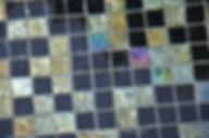 American Made Lightstreams Glass Tile Gold Iridescent Collction Obsidian black tile is used for this all tile spa and wall tile. Can also be used for pool tile, fountain tile, fire pit tile, wall tile, waterline tile, step marker tile, exterior tile, interior tile, accent tile, iridescent tile, backsplash tile, kitchen tile, bathroom tile, floor tile, spillway tile, and shower tile