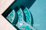 American made Lightstreams Glass Tile Renaissance Colletion Celadon green pool tile on the pool waterline and pool steps as step markers