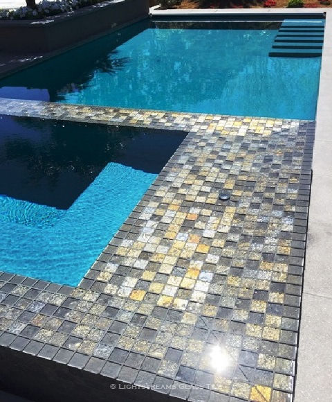 American Made Lightstreams Glass Tile Gold Iridescent Collection Silverado grey tile / silver tile is used for this all tile spa tile. Can also be used for pool tile, fountain tile, fire pit tile, wall tile, waterline tile, step marker tile, exterior tile, interior tile, accent tile, iridescent tile, backsplash tile, kitchen tile, bathroom tile, floor tile, and shower tile. The iridescent tile side plays with the sunlight that shows accent tile.