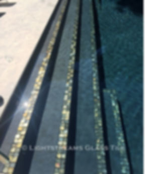 American Made Lightstreams Glass Tile Gold Iridescent Collection Silverado grey tile / silver tile is used for this all tile spa tile. Can also be used for pool tile, fountain tile, fire pit tile, wall tile, waterline tile, step marker tile, exterior tile, interior tile, accent tile, iridescent tile, backsplash tile, kitchen tile, bathroom tile, floor tile, and shower tile. The iridescent tile side is used as step markers for these swimming pool steps.