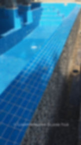 American Made Lightstreams Glass Tile Aqua Blue tile is used as pool tile and spa tile for this all glass tile pool.