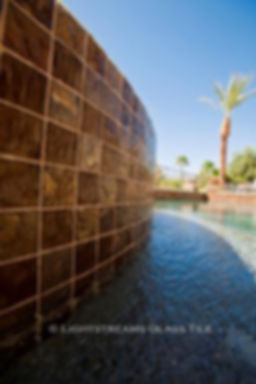American Made Lightstreams Glass Tile Gold Iridescent Collection Bronze tile / brown tile is used for this all tile spa tile. Can also be used for pool tile, fountain tile, fire pit tile, wall tile, waterline tile, step marker tile, exterior tile, interior tile, accent tile, iridescent tile, backsplash tile, kitchen tile, bathroom tile, floor tile, and shower tile