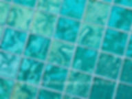 High quality American made Lightstreams Gold Iridescent Collection Aquamarine glasstiles are a beautiful blue / green / aqua color on the shiny side of the tile, with metallic iridescent colors on the reverse side. American made Lightstreams Glass Tile is used for pool tile, spa tile, waterline tile, step marker tile, accent tile, wall tile, fountain tile, floor tile, bathroom tile, shower tile, kitchen tile, and kitchen backsplash tile.