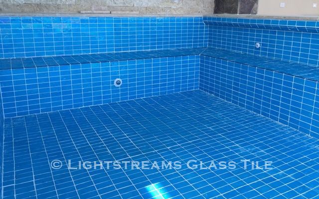 American Made Lightstreams Glass Tile Aqua Blue tile is used as pool tile, wall tile, floor tile, step tile, and spa tile for this all glass tile pool.