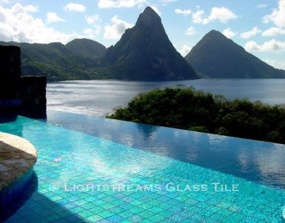 American Made Lightstreams Glass Tile Renaissance Colllection Aqua Blue tile is used as pool tile and spa tile for this outdoor / indoor pool and spa at this luxury St. Lucia Resort. Only the iridescent tile side is shown face up in this all tile pool and all tile spa