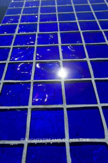 American Made Lightstreams Glass Tile Renaissance Collection Royal Blue tile for this all tile pool tile, spa tile, exterior tile using only the shiny side of the Lightstreams Royal Blue tile.