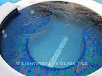 American made Lightstreams Glass Tile Renaissance Collection Peacock Blue tile as the pool tile, spa tile, and waterline tile with accent tile step markers