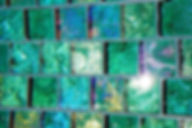 American Made Lightstreams Glass Tile Renaissance Collection Celadon green tile is used on the step of this pool as pool tile, step marker tile, and waterline tile. This photo really shows off the iridescent tile side and the smooth shiny side of Lightstreams signature reversible tile