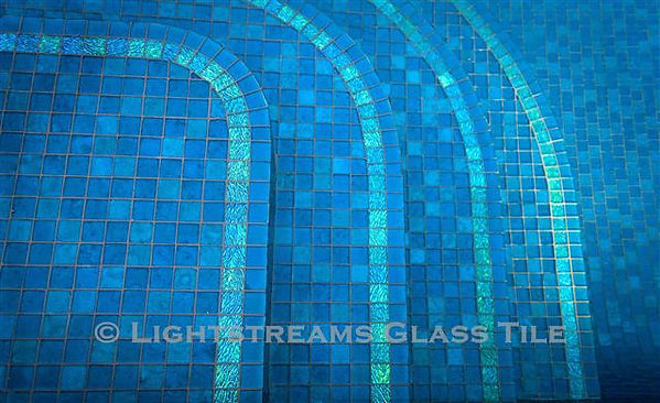 American Made Lightstreams Glass Tile Secret Garden Jewel glass accent tiles are just one of the patterns of Jewel Glass Accent tiles used for accent step markers on this swimming pool floor with Renaissance Collection Turquoise used for the all tile pool floor. This blue tile / green tile jewel glass accent tile can also be used as shower tile, bathroom tile, kitchen tile,  pool tile, spa tile, waterline tile, step marker tile, floor tile, wall tile, and fountain tile.