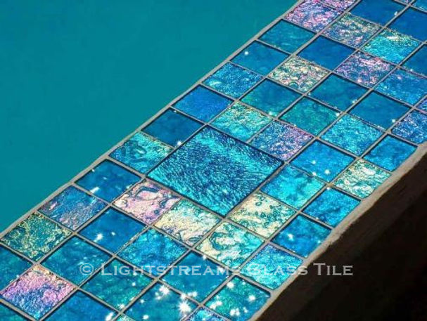 American Made Lightstreams Glass Tile Aqua Blue tile is used as pool tile, waterline tile, and spa tile mixed with Lightstreams accent tile Jewel Aegean Sea
