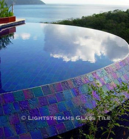 American Made Lightstreams Glass Tile Renaissance Collection Royal Blue tile for this all tile pool tile, spa tile, exterior tile at this luxury St. Lucia resort. This swimming pool tile is using only the iridescent tile side of Lightstreams Royal Blue tile