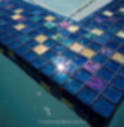 American Made Lightstreams Glass Tile Jewel Accent Tile Red River in this all tile pool with Jewel Red Tile used as accent tile amongst Renaissance Collection Peacock blue tile.  Also can be used as pool tile, waterline tile, spa tile, backsplash tile, kitchen tile, floor tile, wall tile, mosaic tile, bathroom tile, fountain tile, step marker tile, and shower tile.