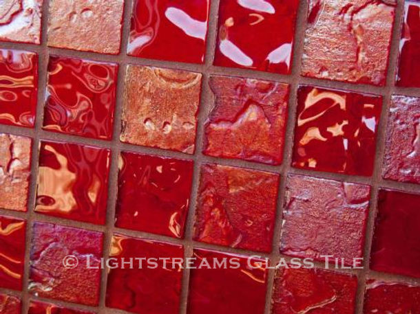 High quality American made Lightstreams Gold Iridescent Collection Crimson glass tiles are a rich, deep merlot red color on the shiny side of the tile, with metallic iridescent colors on the reverse side. American made Lightstreams Glass Tile is used for pool tile, spa tile, waterline tile, step marker tile, accent tile, wall tile, fountain tile, floor tile, bathroom tile, shower tile, kitchen tile, and kitchen backsplash tile.