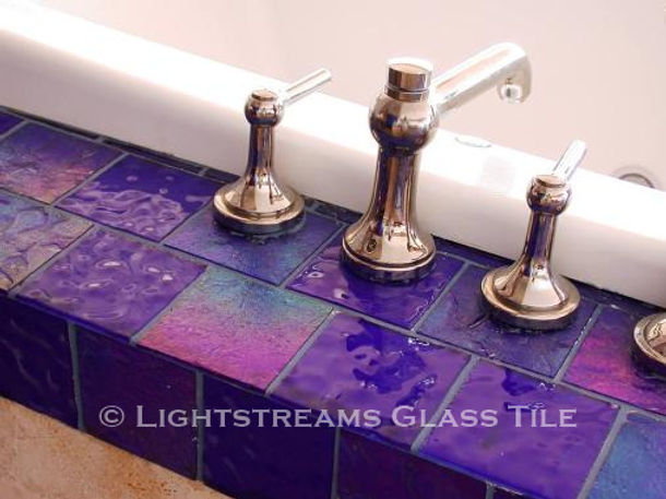American Made Lightstreams Glass Tile Renaissance Collection Royal Blue tile outlines this bathroom tub accenting as bathroom tile accent tile spa tile